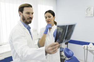 doctors looking at x rays as part of oral cancer screenings in Fort Worth TX