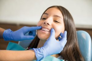 teen girl receiving available orthodontic treatment in Fort Worth TX