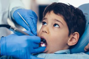 young boy receiving the pediatric dentistry services Fort Worth TX offers