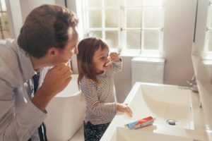 dad and daughter brushing teeth for at home preventative dentistry services in fort worth tx