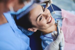 female patient receiving the professional teeth cleaning fort worth tx offers